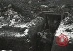 Image of US Army soldiers prepare for gas attack in World War 1 trench France, 1918, second 23 stock footage video 65675021500