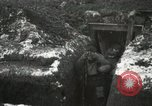 Image of US Army soldiers prepare for gas attack in World War 1 trench France, 1918, second 26 stock footage video 65675021500