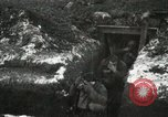 Image of US Army soldiers prepare for gas attack in World War 1 trench France, 1918, second 27 stock footage video 65675021500