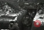 Image of US Army soldiers prepare for gas attack in World War 1 trench France, 1918, second 28 stock footage video 65675021500