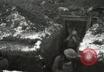 Image of US Army soldiers prepare for gas attack in World War 1 trench France, 1918, second 29 stock footage video 65675021500