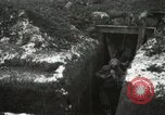 Image of US Army soldiers prepare for gas attack in World War 1 trench France, 1918, second 30 stock footage video 65675021500