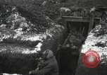 Image of US Army soldiers prepare for gas attack in World War 1 trench France, 1918, second 32 stock footage video 65675021500