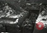 Image of US Army soldiers prepare for gas attack in World War 1 trench France, 1918, second 33 stock footage video 65675021500