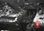 Image of US Army soldiers prepare for gas attack in World War 1 trench France, 1918, second 34 stock footage video 65675021500