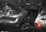Image of US Army soldiers prepare for gas attack in World War 1 trench France, 1918, second 35 stock footage video 65675021500
