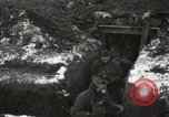 Image of US Army soldiers prepare for gas attack in World War 1 trench France, 1918, second 36 stock footage video 65675021500
