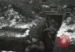 Image of US Army soldiers prepare for gas attack in World War 1 trench France, 1918, second 37 stock footage video 65675021500
