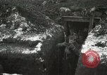 Image of US Army soldiers prepare for gas attack in World War 1 trench France, 1918, second 38 stock footage video 65675021500