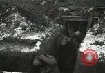 Image of US Army soldiers prepare for gas attack in World War 1 trench France, 1918, second 39 stock footage video 65675021500