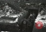 Image of US Army soldiers prepare for gas attack in World War 1 trench France, 1918, second 40 stock footage video 65675021500