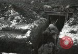 Image of US Army soldiers prepare for gas attack in World War 1 trench France, 1918, second 41 stock footage video 65675021500