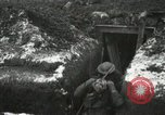 Image of US Army soldiers prepare for gas attack in World War 1 trench France, 1918, second 42 stock footage video 65675021500