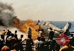 Image of wrecked planes and fire on USS Yorktown World War 2 Pacific Theater, 1944, second 36 stock footage video 65675021565