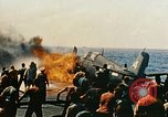 Image of wrecked planes and fire on USS Yorktown World War 2 Pacific Theater, 1944, second 39 stock footage video 65675021565