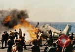 Image of wrecked planes and fire on USS Yorktown World War 2 Pacific Theater, 1944, second 42 stock footage video 65675021565