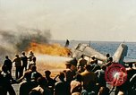 Image of wrecked planes and fire on USS Yorktown World War 2 Pacific Theater, 1944, second 45 stock footage video 65675021565