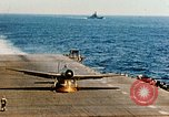 Image of wrecked planes and fire on USS Yorktown World War 2 Pacific Theater, 1944, second 59 stock footage video 65675021565