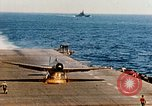 Image of wrecked planes and fire on USS Yorktown World War 2 Pacific Theater, 1944, second 60 stock footage video 65675021565