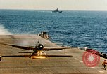 Image of wrecked planes and fire on USS Yorktown World War 2 Pacific Theater, 1944, second 61 stock footage video 65675021565