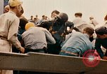 Image of burial at sea aboard USS Yorktown in World War  Pacific Theater, 1944, second 48 stock footage video 65675021567