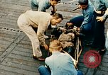 Image of burial at sea aboard USS Yorktown in World War  Pacific Theater, 1944, second 52 stock footage video 65675021567