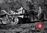 Image of Clearing trees for more farm land United States USA, 1939, second 19 stock footage video 65675021577