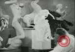 Image of German sculptor Germany, 1942, second 7 stock footage video 65675021787