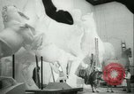 Image of German sculptor Germany, 1942, second 49 stock footage video 65675021787