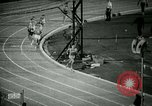 Image of Jim Ryun breaking world record mile Bakersfield California USA, 1967, second 6 stock footage video 65675021956