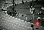 Image of Jim Ryun breaking world record mile Bakersfield California USA, 1967, second 7 stock footage video 65675021956