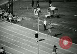 Image of Jim Ryun breaking world record mile Bakersfield California USA, 1967, second 8 stock footage video 65675021956