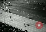 Image of Jim Ryun breaking world record mile Bakersfield California USA, 1967, second 10 stock footage video 65675021956