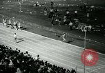 Image of Jim Ryun breaking world record mile Bakersfield California USA, 1967, second 12 stock footage video 65675021956