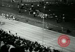 Image of Jim Ryun breaking world record mile Bakersfield California USA, 1967, second 13 stock footage video 65675021956