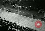 Image of Jim Ryun breaking world record mile Bakersfield California USA, 1967, second 14 stock footage video 65675021956