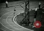 Image of Jim Ryun breaking world record mile Bakersfield California USA, 1967, second 22 stock footage video 65675021956