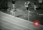 Image of Jim Ryun breaking world record mile Bakersfield California USA, 1967, second 25 stock footage video 65675021956
