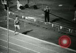 Image of Jim Ryun breaking world record mile Bakersfield California USA, 1967, second 26 stock footage video 65675021956