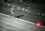 Image of Jim Ryun breaking world record mile Bakersfield California USA, 1967, second 27 stock footage video 65675021956