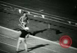 Image of Jim Ryun breaking world record mile Bakersfield California USA, 1967, second 29 stock footage video 65675021956