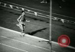 Image of Jim Ryun breaking world record mile Bakersfield California USA, 1967, second 30 stock footage video 65675021956