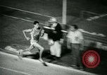 Image of Jim Ryun breaking world record mile Bakersfield California USA, 1967, second 32 stock footage video 65675021956