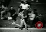 Image of Jim Ryun breaking world record mile Bakersfield California USA, 1967, second 37 stock footage video 65675021956