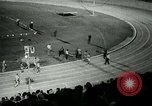 Image of Jim Ryun breaking world record mile Bakersfield California USA, 1967, second 41 stock footage video 65675021956