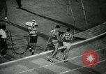 Image of Jim Ryun breaking world record mile Bakersfield California USA, 1967, second 43 stock footage video 65675021956