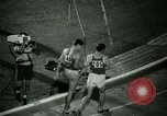 Image of Jim Ryun breaking world record mile Bakersfield California USA, 1967, second 44 stock footage video 65675021956