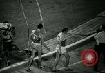 Image of Jim Ryun breaking world record mile Bakersfield California USA, 1967, second 45 stock footage video 65675021956