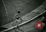 Image of Jim Ryun breaking world record mile Bakersfield California USA, 1967, second 47 stock footage video 65675021956