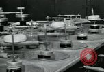 Image of PrecisionGrinding of glass lenses Anaheim California USA, 1960, second 8 stock footage video 65675022147